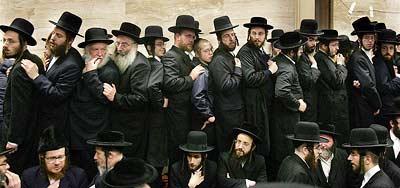 Hassidic Jews all dressed in black