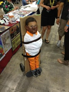 It's bad enough the parents of this little boy have dressed him as serial killer Hannibal Lecter from Silence of the Lambs, but their real crime in binding their kid  so he can't grab any candy.