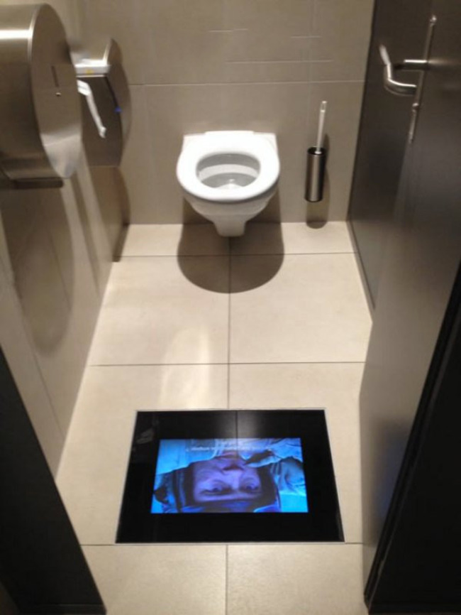 Movie theater bathrooms with built-in movie screens. So you won't miss!