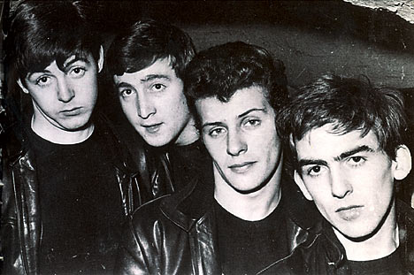 "Here's a very early photo of the Fab Four--John, Paul, George and, hey, where's Ringo? Hey, this must be ""the Best Beatles"" because it feature Pete Best, before Ringo replaced him,"