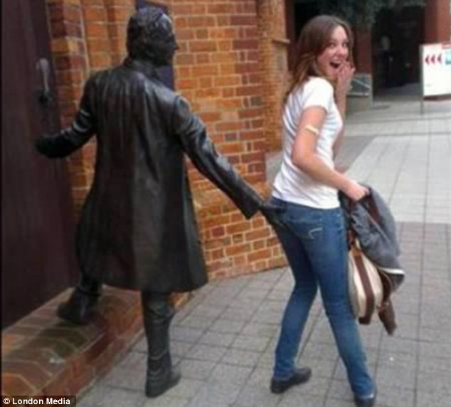 statue pulling passerby's pants down