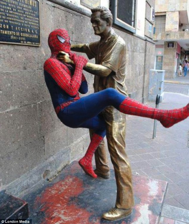 statue strangling Spiderman